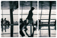 Silhouette of man at the airport with luggage Royalty Free Stock Image