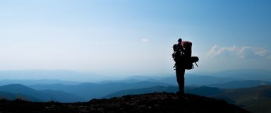 Silhouette of man with baby son in mountainous  areas. Royalty Free Stock Photography