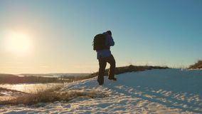 Silhouette of a man with a backpack against bright sky sunset. Sun goes down. Travel Concept. Tourist go travel nature stock video footage