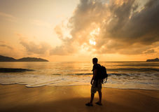 Silhouette of a man with a backpack Stock Image