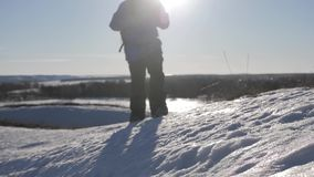 Silhouette of man with a backpack walking in a winter landscape on snowshoes. Concept adventure activity hobby extreme. Silhouette of man with a backpack stock video