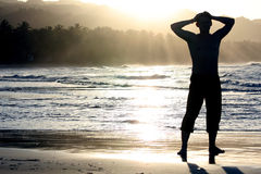 Silhouette of man on the beach Stock Photography