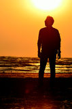 Silhouette man on beach with sunset sky background Royalty Free Stock Photo