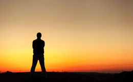 Silhouette of man and beautiful sky. Element of design. Royalty Free Stock Images
