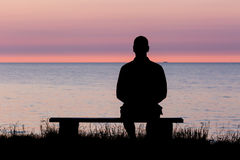 Silhouette of man on bench Royalty Free Stock Photo