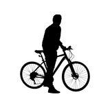 Silhouette man on a bicycle Stock Photo