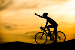 Silhouette of man on bicycle Royalty Free Stock Images