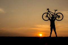 Silhouette of man and bicycle Royalty Free Stock Photography