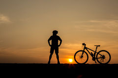 Silhouette of man and bicycle Stock Images