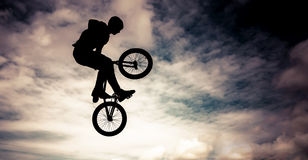 Silhouette of a man with bmx bike. Stock Image