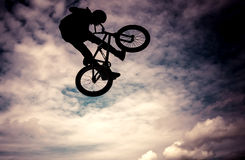 Silhouette of a man with bmx bike. Stock Photo