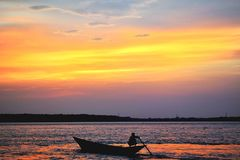 Silhouette Of Man On Boat In Water Royalty Free Stock Photo