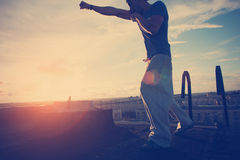 Silhouette of man boxing with shadow. On the roof at sunset Royalty Free Stock Images