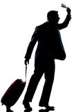 Silhouette man business traveler  hurrying late. One caucasian business traveler man walking with suitcase hurrying late  full length silhouette in studio Stock Images