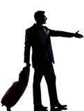 Silhouette man business traveler man handshake. One caucasian man one caucasian business traveler man handshake  with suitcase  full length silhouette in studio Stock Photos