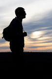 Silhouette of a man with a camera Stock Photography
