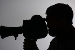 Silhouette of man camera side Stock Photo