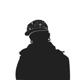 Silhouette of a man in a cap with space print and with ear flesh tunnels. Informal stylish guy Stock Image