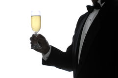 Silhouette Man with Champagne Glass. Man in Tuxedo in Silhouette Holding a Glass of Champagne stock image