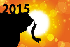 2015 and silhouette of man climbing Stock Images