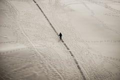 Silhouette of a man climbing at mingsha shan sand mountain China Royalty Free Stock Photo