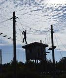 Silhouette man climbing Royalty Free Stock Photo