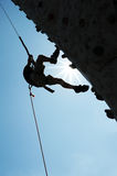 Silhouette of man on climbing wall