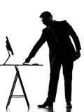 Silhouette  man  computing Stock Photo