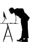 Silhouette  man  computing Royalty Free Stock Photo