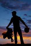 Silhouette man cowboy saddle hold hat Royalty Free Stock Photos
