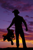 Silhouette man cowboy saddle wear hat Royalty Free Stock Images