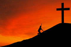 Silhouette of man with the Cross. Christian background: Silhouette of man kneeling down by the cross Royalty Free Stock Photos
