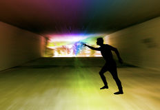 Silhouette of a man in a dark tunnel with a spectral light Stock Photos