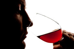 Silhouette of man degusting wine Stock Photo