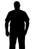 Silhouette of a man with a dense constitution ful Royalty Free Stock Photos