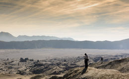 Silhouette of Man on Desert Sand. During Sunrise Stock Photos
