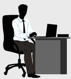 Silhouette man at the Desk with laptop. Silhouette office man behind a Desk with a laptop Royalty Free Stock Images