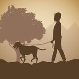 Silhouette man and dog walk forest background Stock Photography