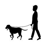 Silhouette man and dog walking Stock Photo