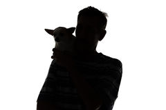 Silhouette of a man with the dog Stock Photos