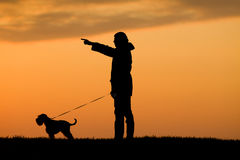 Silhouette of man and dog Royalty Free Stock Image