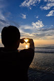Silhouette of man doing heart shape Royalty Free Stock Images