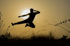 Silhouette of Man Doing Kick Jump during Sunset Royalty Free Stock Photo