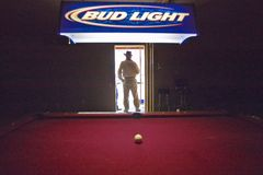 Silhouette of a man in the doorway of a pool hall in Lima Montana Stock Photos