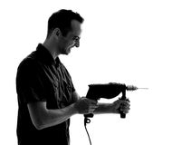 Silhouette of man with drilling machine Royalty Free Stock Image
