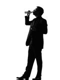 Silhouette  man  drinking Stock Images