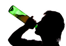 Silhouette of man drinking alcoho Stock Photography