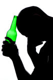 Silhouette of man drinking alcohol Stock Photos