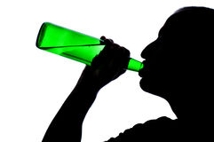 Silhouette of man drinking alcohol Royalty Free Stock Photos