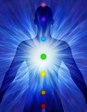 Silhouette of man with energy rays. And the mark of the chakras Royalty Free Stock Photos